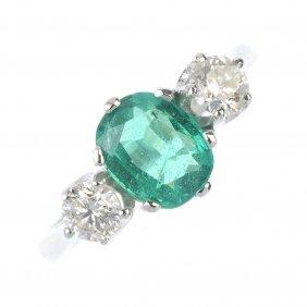 An Emerald And Diamond Three-stone Ring.