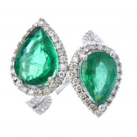 An Emerald And Diamond Crossover Ring.