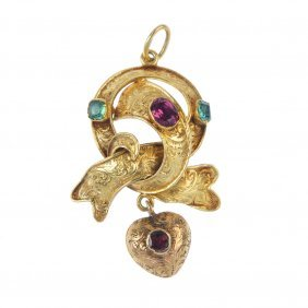 A Mid 19th Century Gold Emerald And Garnet Pendant. The