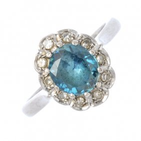 An 18ct Gold Zircon And Diamond Cluster Ring. The