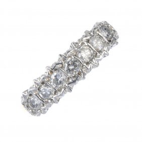 A 9ct Gold Diamond Dress Ring. The Brilliant-cut