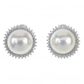A Pair Of 18ct Gold Mabe Pearl Ear Studs. Each Designed