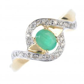 A 9ct Gold Emerald And Diamond Dress Ring. The