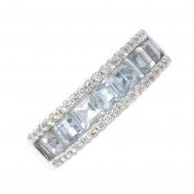 An Aquamarine And Diamond Band Ring. The Square-shape