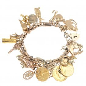 A Charm Bracelet. The Trombone And Belcher-link Chain,