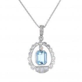 An Aquamarine And Diamond Pendant. The