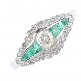 A Diamond And Emerald Dress Ring. Of Marquise-shape