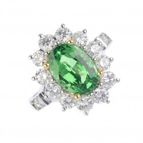 An 18ct Gold Tsavorite And Diamond Cluster Ring. The