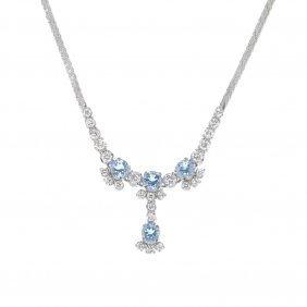 An Aquamarine And Diamond Necklace. The Circular-shape
