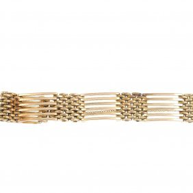 An Early 20th Century 15ct Gold Bracelet. Designed As