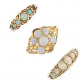 Three 9ct Gold Opal Rings. To Include A Cluster Ring