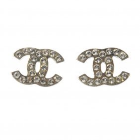 Chanel - A Pair Of Ear Studs. Each Designed As