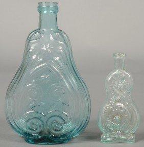Two Aquamarine Glass Bottles; 1st Is A Quart Size