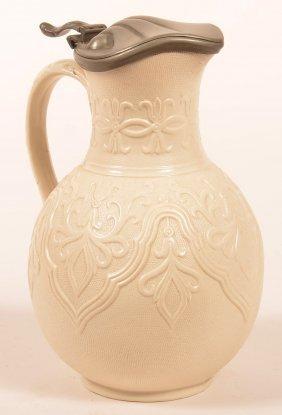 English Stoneware Pewter Mounted Syrup Jug.