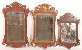Three Chippendale Mahogany Wall Mirrors.