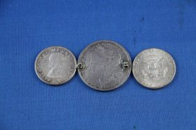TWO SILVER U.S. HALF DOLLARS PLUS 1880 COIN BROOCH