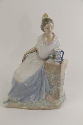 Nao Figurine - Lady Seated On Wall With Pitcher