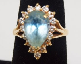 14k Yellow Gold Ladies Ring With Pear Shaped Blue