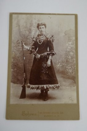 Cowgirl With Rifle Cabinet Photo