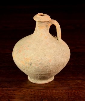 A Roman Earthenware Flask 6 Ins (15 Cms) In Height.