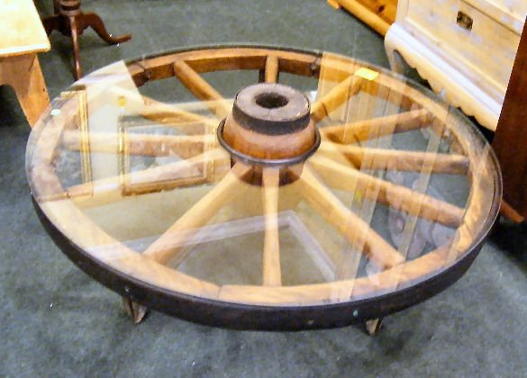 218d wagon wheel glass top coffee table w iron legs for Glass top coffee table with wheels