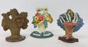 Three Painted Cast Iron Floral Door Stops