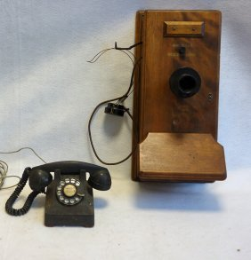 Two Telephones Including A Western Electric Oak Wall