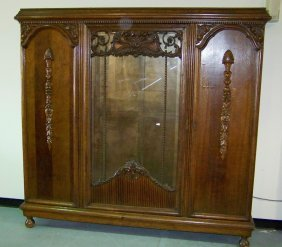 Antique Carved Display Front Armoire On Bun Feet