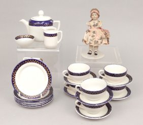 Child's Tea Set And A Bisque Doll