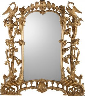 A George Ii-style Carved Giltwood Figural Mirror