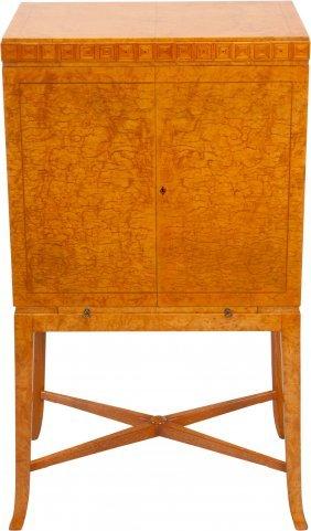 A Terence Harold Robsjohn-gibbings Burled Maple,
