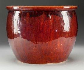A Continental Oxblood-glazed Ceramic Planter 12