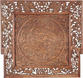 A Chinese Carved Teak Panel: Dragon, 20th Centur