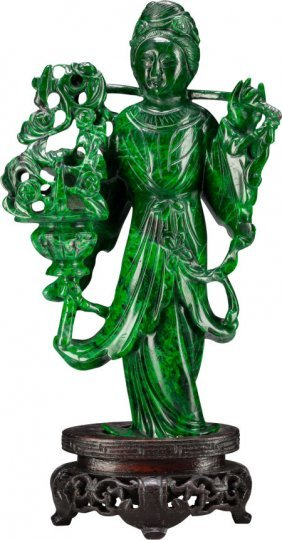 A Chinese Carved Malachite Figure Holding A Bask