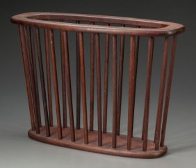 An Arthur Umanoff Walnut Magazine Rack, 20th Cen