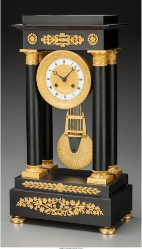 A French Empire-style Ebonized Wood And Gilt Bro