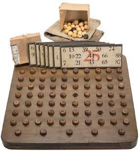 A Keno Ball Board With 73 (of 75) Wood Keno Balls, An