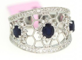 14KT White Gold 1.03ct Sapphire Trio And Diamond Ring F