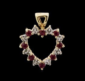 Blue Topaz, Garnet And Diamond Pendant - 14kt Yellow