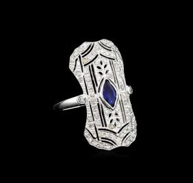 0.50ct Blue Sapphire And Diamond Ring - 18kt White Gold
