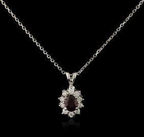 14kt White Gold 0.66ct Ruby And Diamond Pendant With